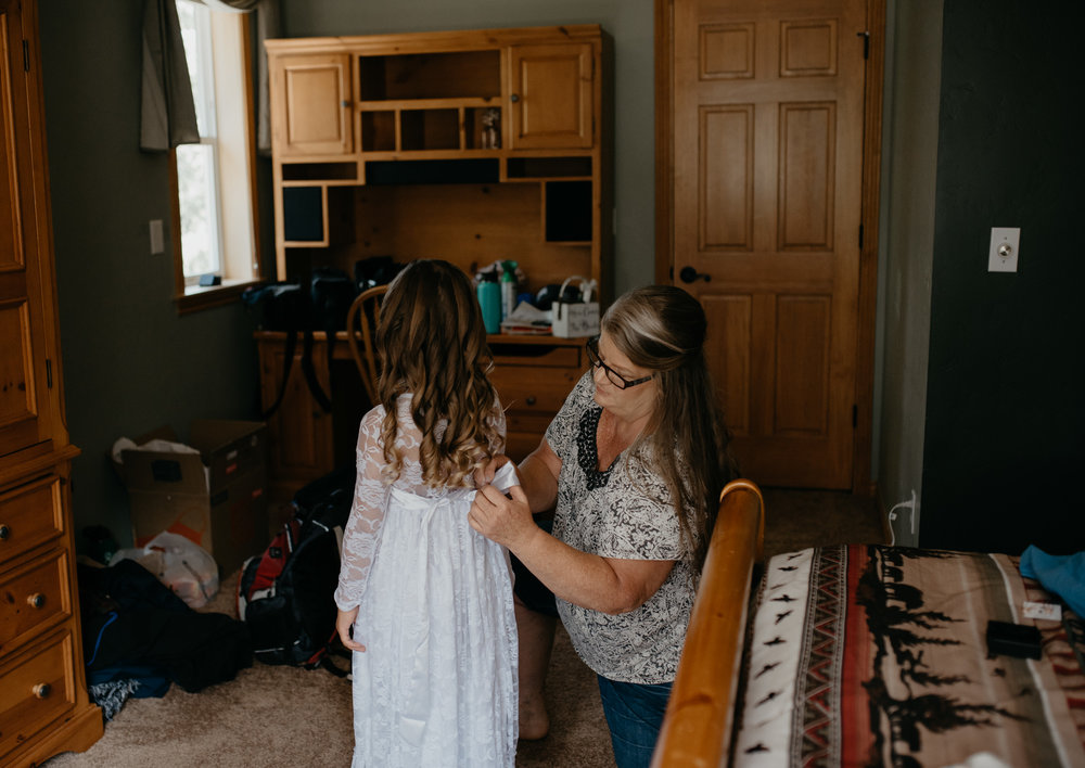Mom and flower girl getting ready. Colorado elopement photographer.