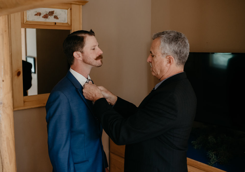 Sapphire Point intimate wedding in Colorado. Groom getting ready. Colorado wedding and elopement photographer.