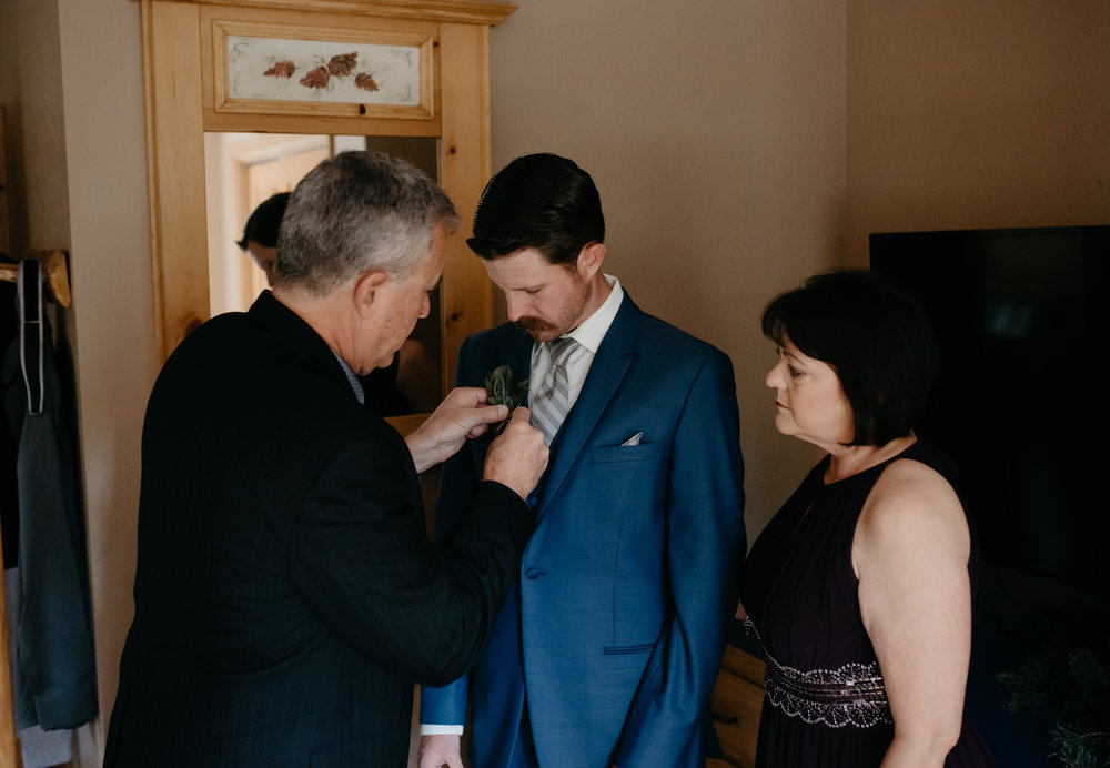 Groom prep at Sapphire Point intimate wedding. Colorado elopement and wedding photographer.