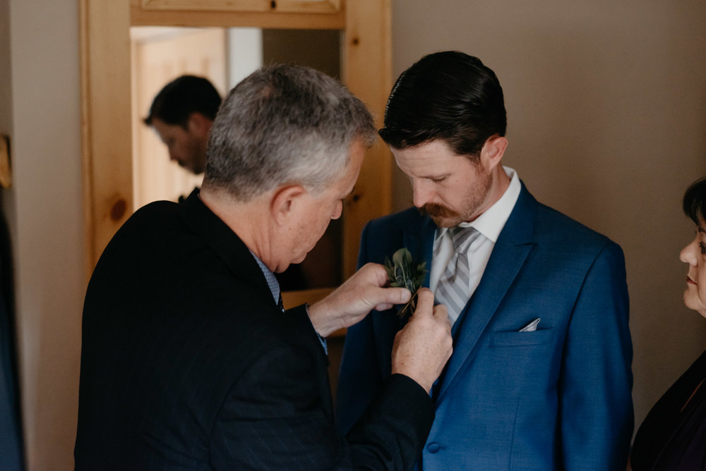 Getting ready photos at Sapphire Point elopement in Colorado.