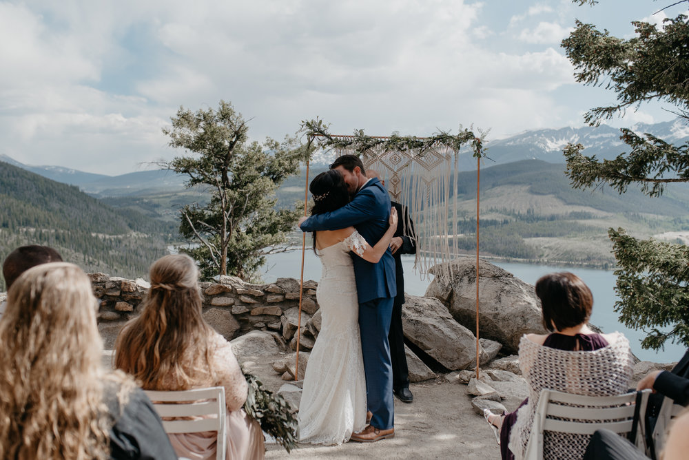 First Kiss at wedding in Colorado. Sapphire Point wedding photographer.