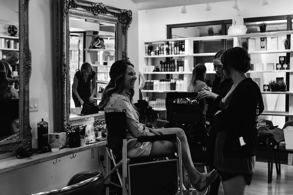 Bride getting ready at Salon Tullio in Aspen, Colorado. Colorado wedding photographer.