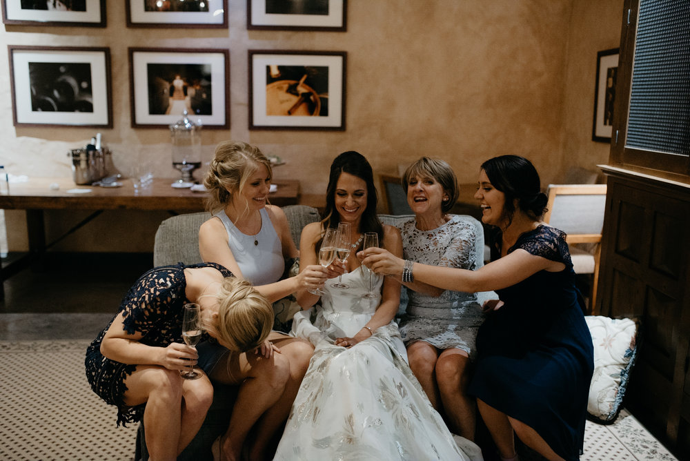 Girls doing toast before wedding at The Little Nell. Aspen, Colorado wedding photographer