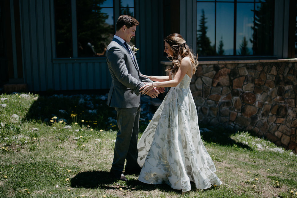 First look with bride and groom taken by Aspen wedding photographer.
