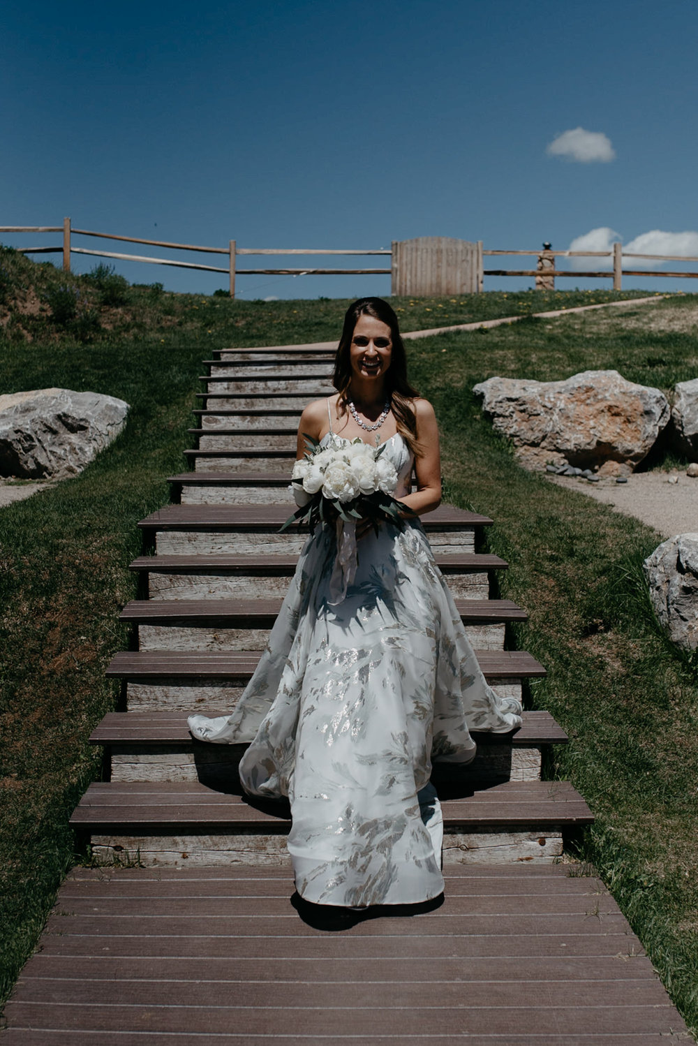 Bride walking down isle at The Little Nell. Aspen, Colorado elopement and wedding photographer.