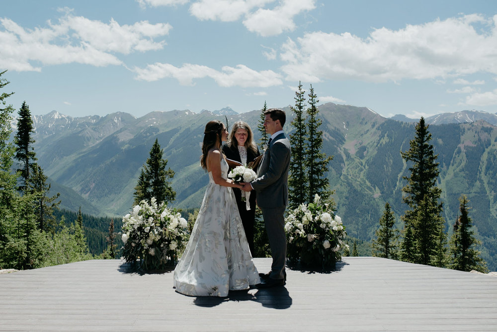 The Little Nell wedding ceremony at Aspen Wedding Deck. Colorado wedding photographer