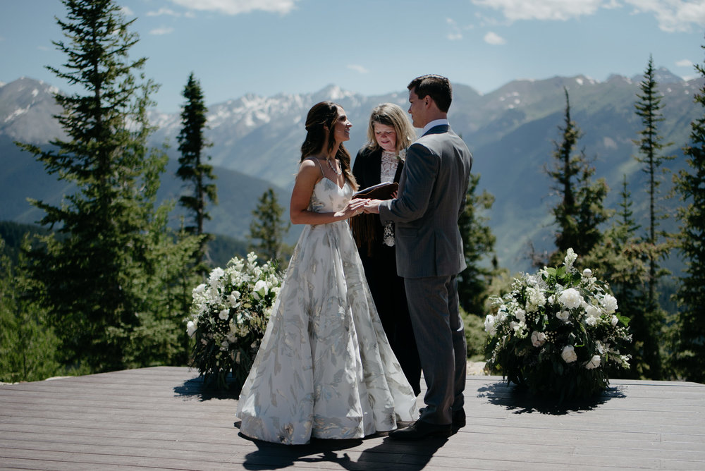 Mountain wedding at The Little Nell.. Aspen wedding deck ceremony.