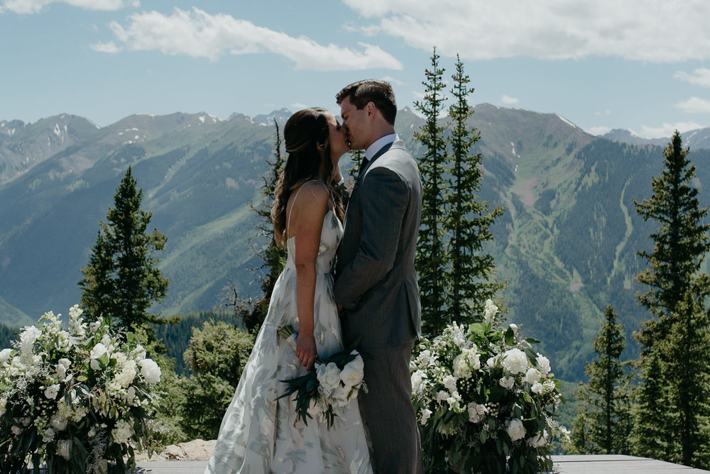 First kiss by Aspen wedding photographer at The Little Nell.