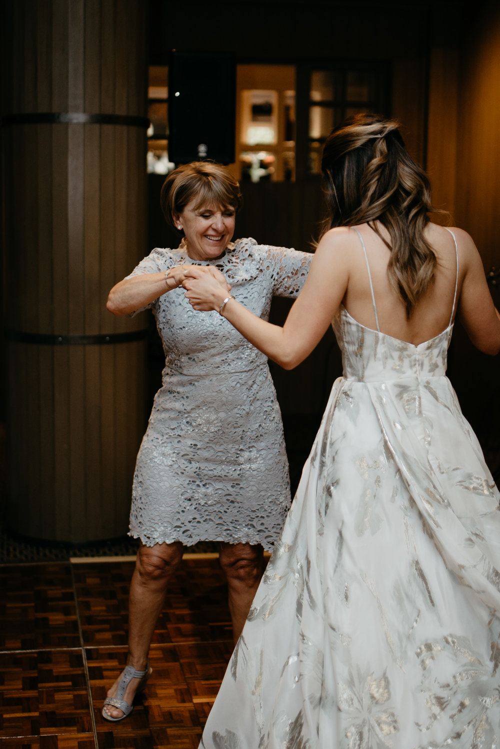Mom and daughter dancing at The Little Nell taken by an Aspen, Colorado wedding and elopement photographer.