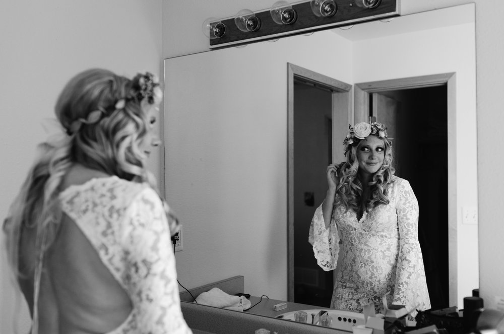 Boho bride getting ready before ceremony in Rocky Mountain National Park.