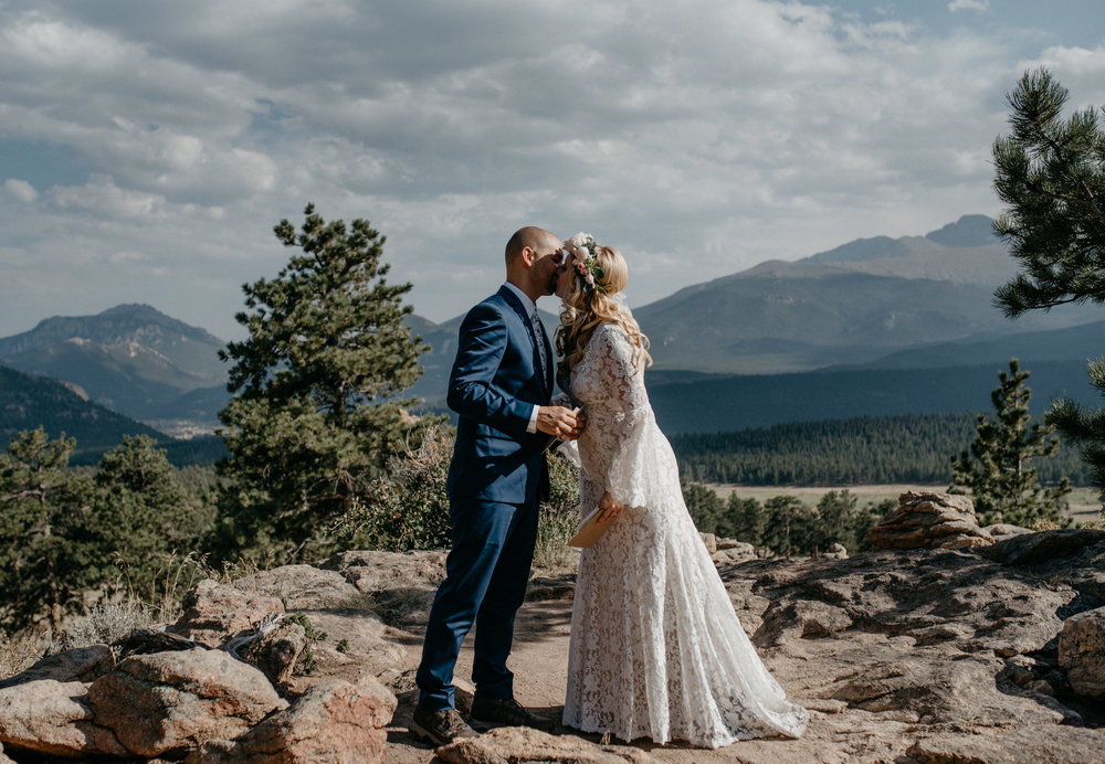 First kiss at Rocky Mountain National Park elopement at 3M curve. Colorado elopement photographer.
