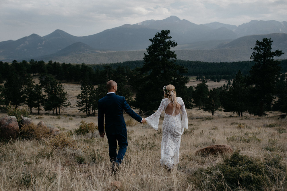 Bride and groom portraits at an elopement in Rocky Mountain National Park at 3M curve.