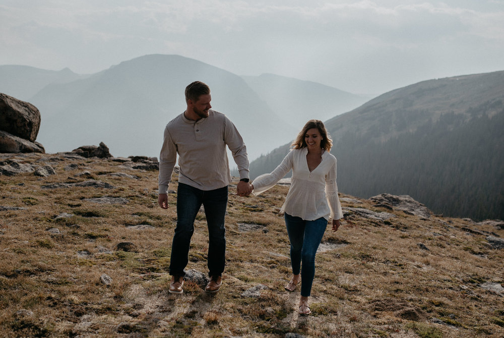 Colorado engagement session photographer. Rocky Mountain National Park adventure engagement photos on Trail Ridge Road. Estes Park, Colorado elopement and wedding photographer.