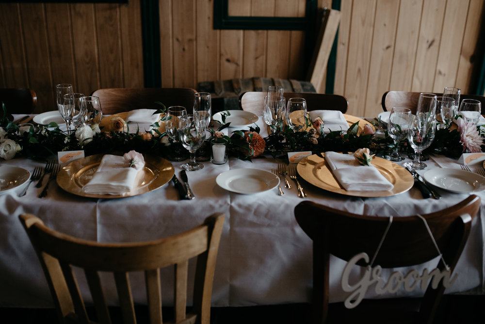 Table center pieces at Three Leaf Farm wedding. Colorado elopement and wedding photographer for adventurous couples.