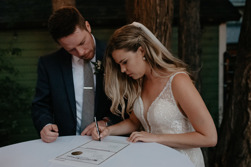 Bride and groom signing marriage license at Three Leaf Farm wedding. Boulder, Colorado wedding and elopement photographer. Colorado affordable wedding photography.