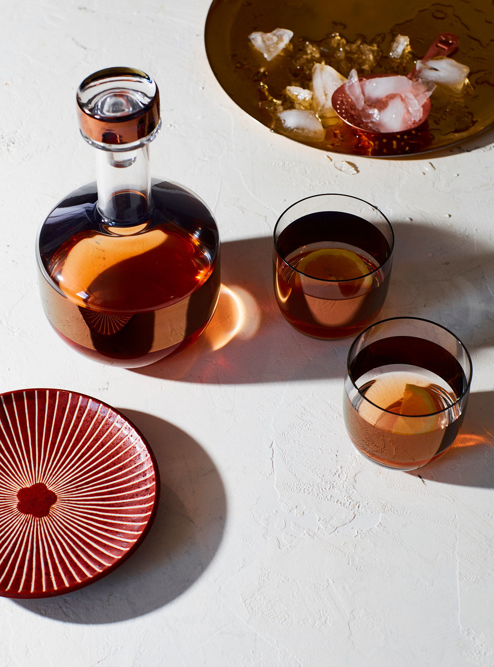 Decanter and Vessels by Tom Dixon Studio - Ice bowl from Michele Varian - Plate from Aero Studios