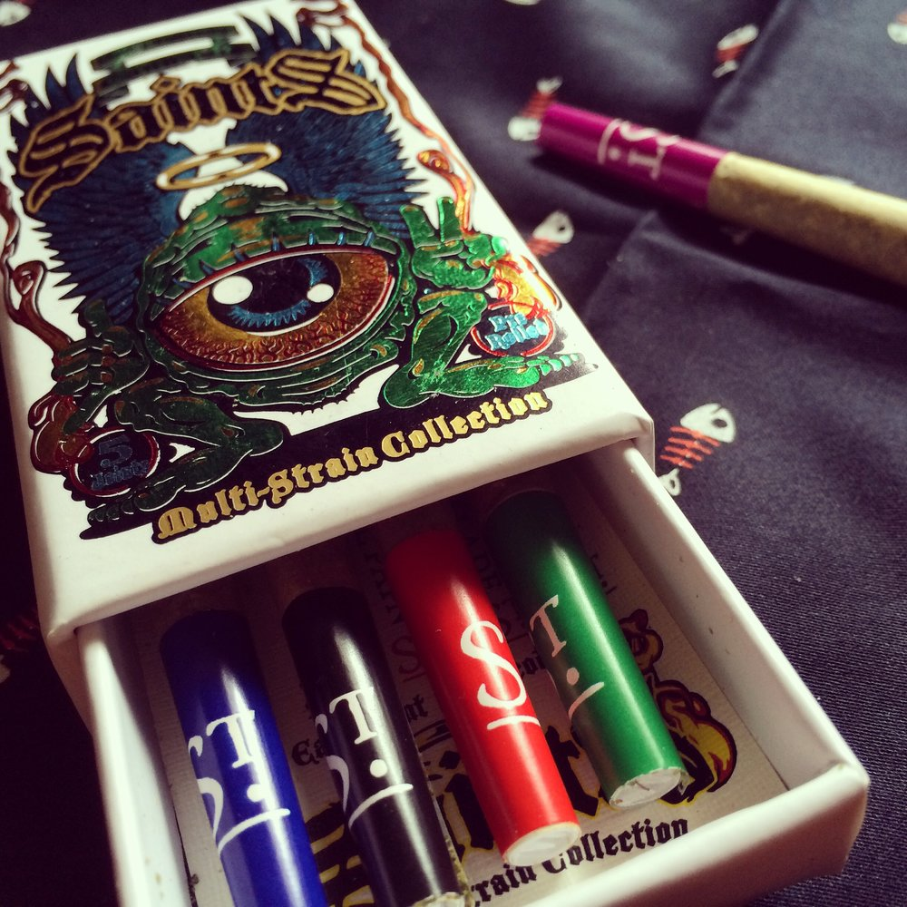 Saints multi-strain joint pack ($40) - Five joints, each made from a different strain of top-shelf Saints flower, color-coded with their strain name, and in a gorgeously printed, reusable, collectible box with custom art by Jimbo Phillips. Our staff's favorite box of joints, hands down.