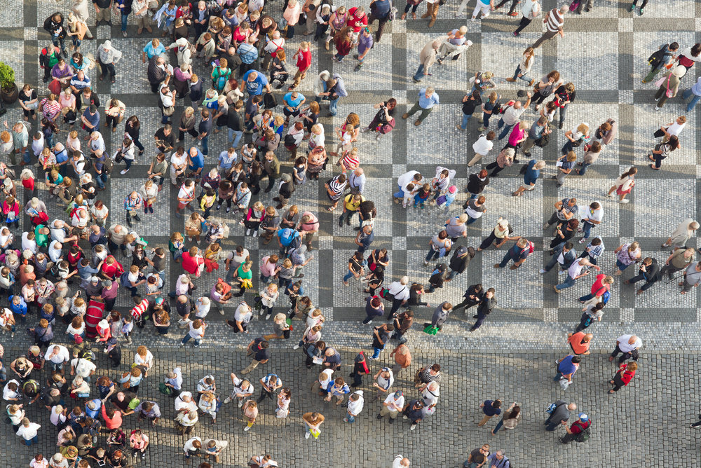 AdobeStock_people standing town square aerial.jpeg