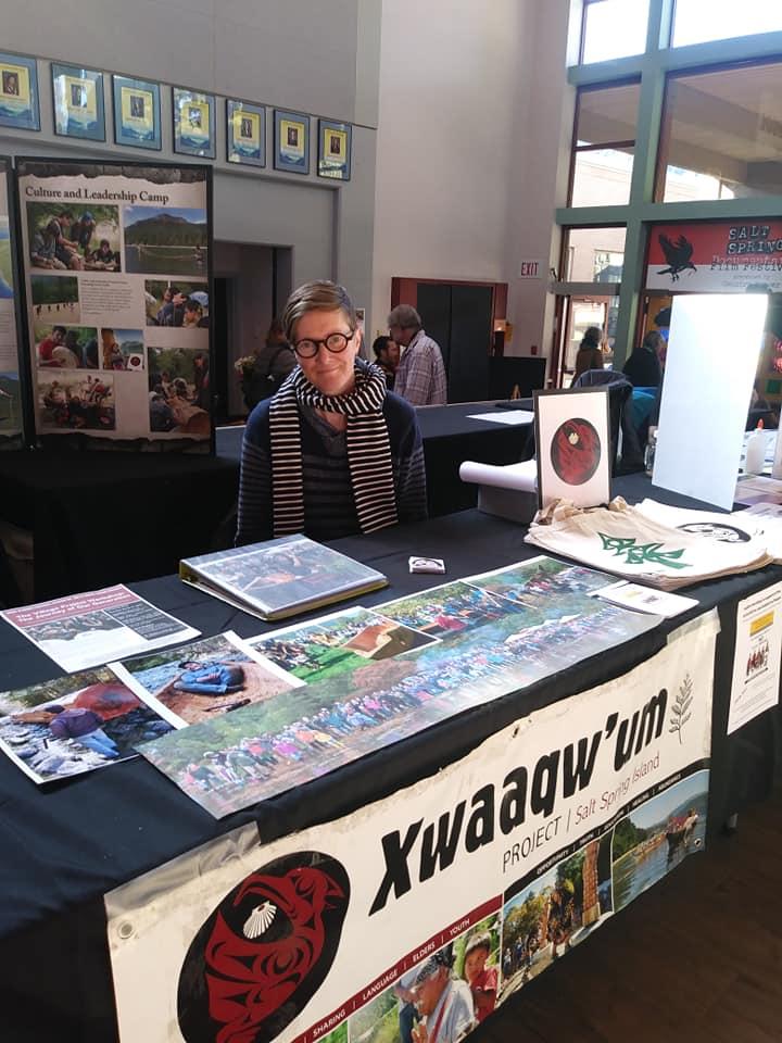 Volunteer Kait Leslie at the Xwaaqw'um table.