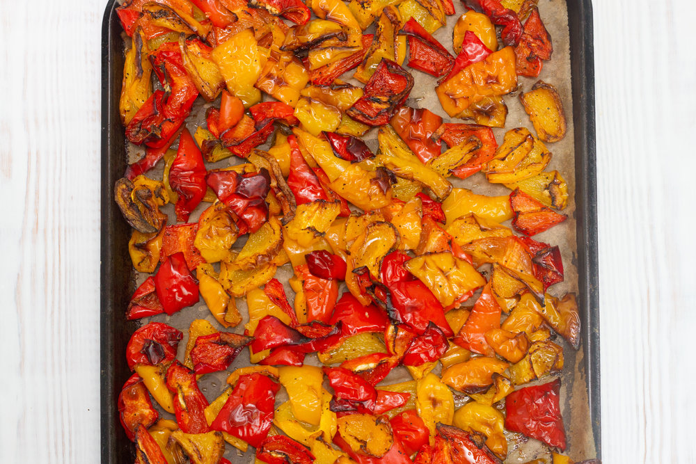Fresh peppers are washed, cut and roasted on brown paper with a little extra virgin olive oil and seasoning.