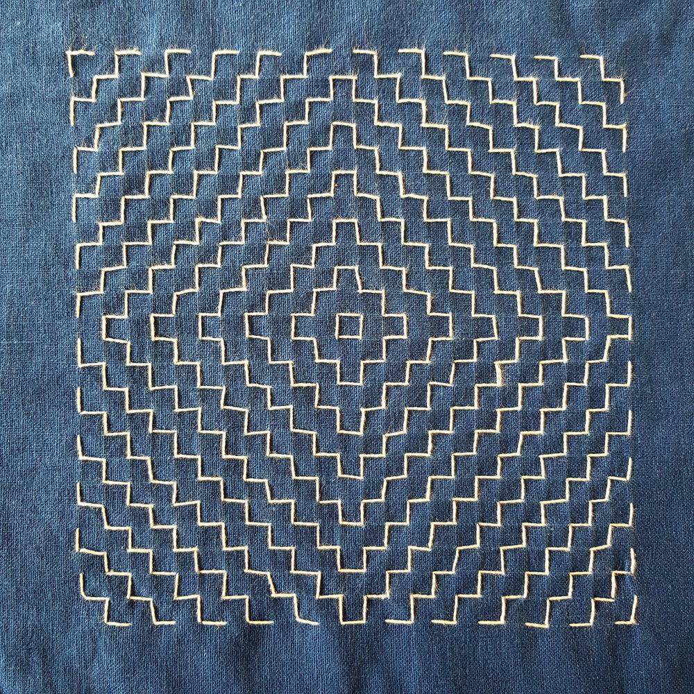 Yamagata (Mountain form) Hitomezashi sashiko stitching on indigo dyed linen (from a drawn grid)