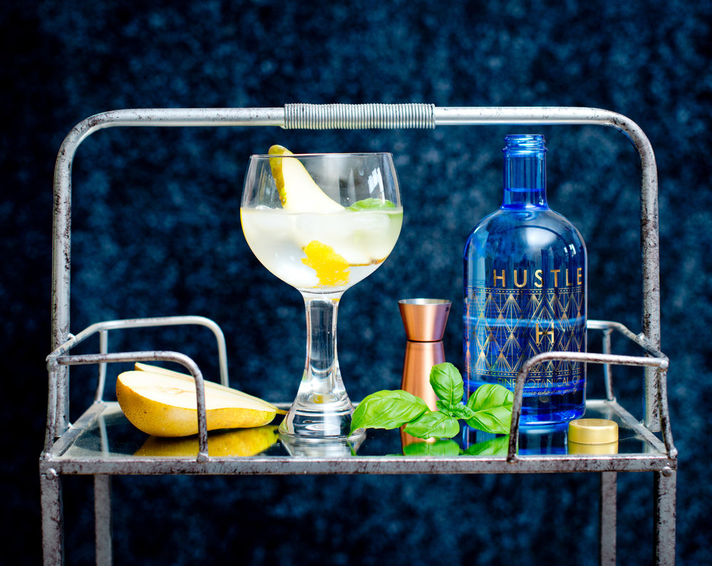 The Hustle - Ice in a chilled glass25 ml Hustle GinA sling of Vermouth (15 ml)15 ml Elderflower CordialTop up with tonic of your choiceGarnish with a wafer thin slice of pear & fresh basil