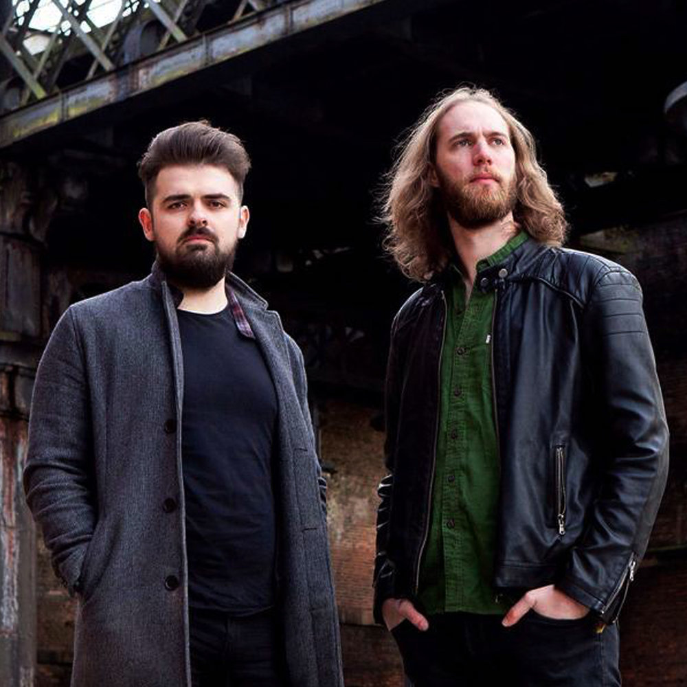 ARTIST/RIVAL BONES - Debuting in 2015 with the release of 'You Know Who You Are' Rival Bones firmly planted their mic stands and well-worn drumsticks into UK rock soil.Having carved out a distinct sound with hard-hitting riffs and fiery lyrics, the duo generate a roar that belies their modest gang of two.