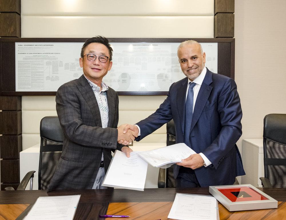 Chong Huat Tan with Chestertons Chairman Salah Mussa