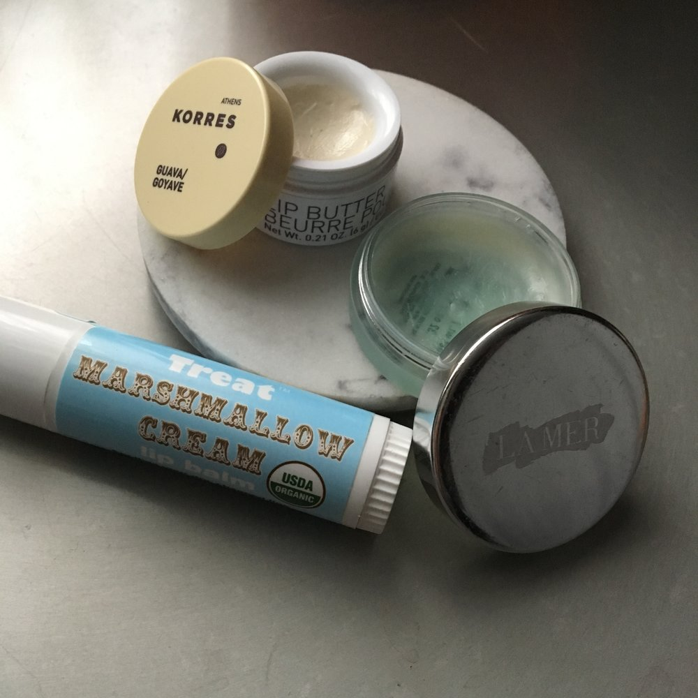 Korres Lip Butter, La Mer The Lip Treatment, TREAT Beauty Marshmallow Cream Lip Balm