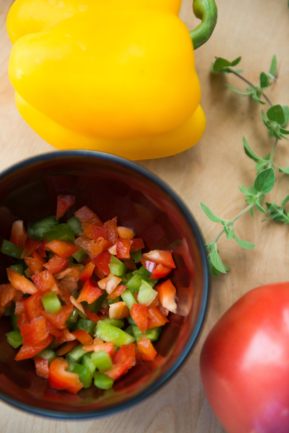 Sauté onion, chopped pepper, tomato, and garlic over moderate heat, stirring, for 15 minutes.  -