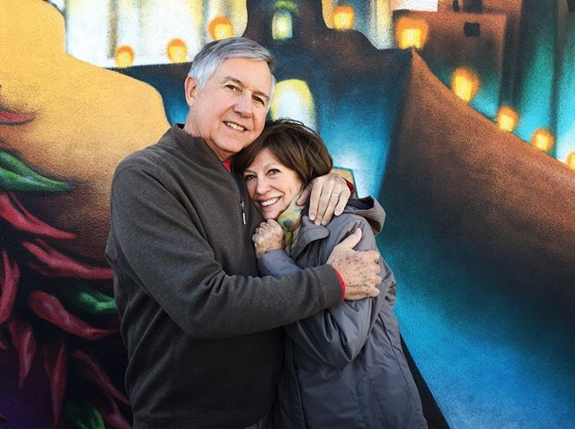 "Can we take a moment for how cute my parents are? This is another photo from New Mexico, they go to Santa Fe about 5 times a year, and if you've never been, you're missing out. But back to these two. I know I'm biased, but has there ever been a cuter couple? Even after all these years, my dad still will stop the conversation to say, ""Look at your mother, look how beautiful she is"" - it's the sweetest thing ever. And while I'm sure it hasn't always been easy, it works because they are SO DIFFERENT. He's a detail-oriented lawyer, she's a quirky artist. (They're both environmentalists, btw!) He jokes he knew she was the one when, on their third date, my mom tired of all the dinners and long walks to feed the ducks and threw her dorm room open and greeted him by demanding, ""When are you going to take me to drink some beer, you old fart?"" Missing these sweet faces today. 💚⁣ .⁣ .⁣ .⁣ #love #myparents #family"
