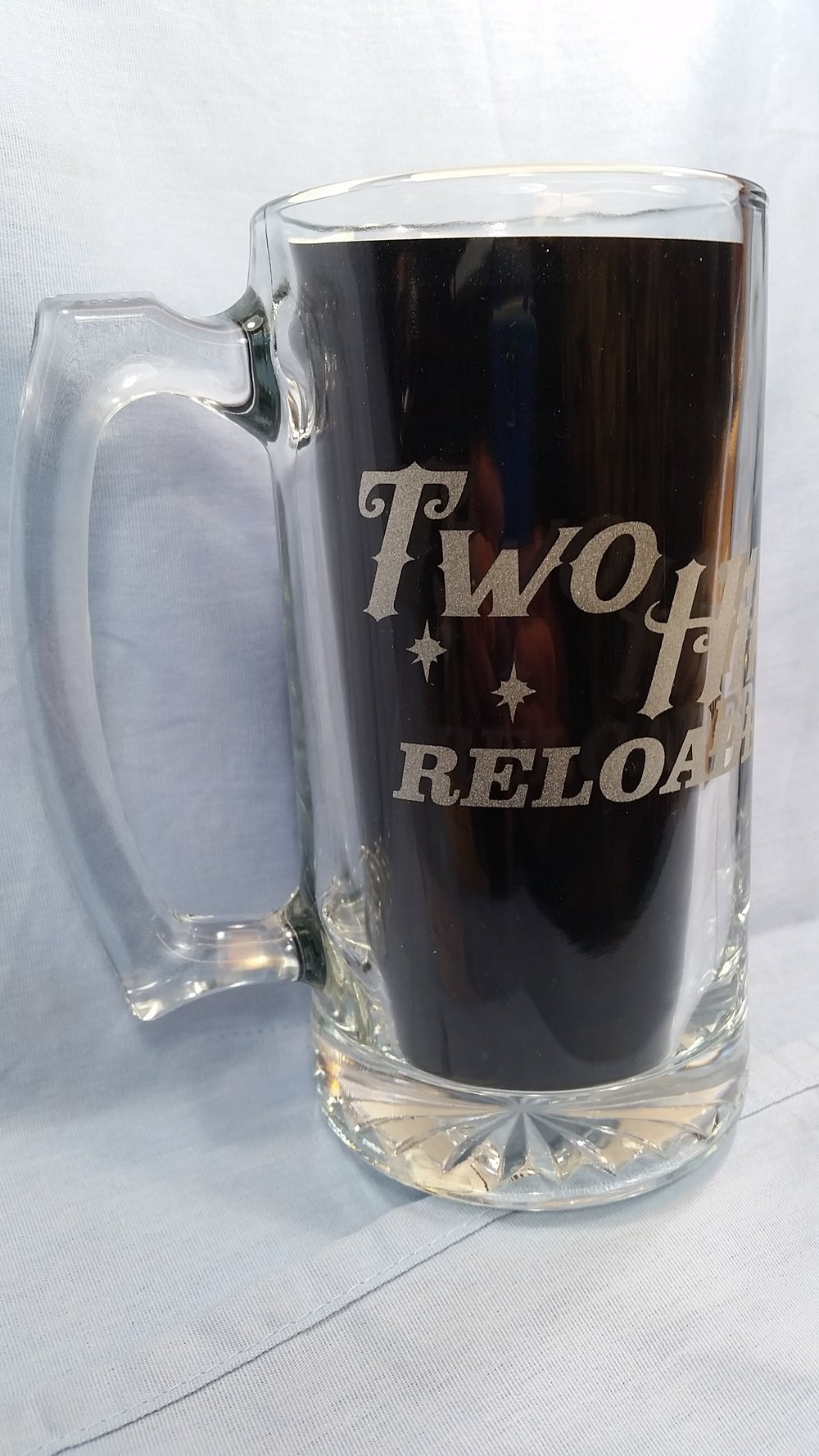 Have your next cold one in this 24oz Beer Mug. Glass etched Two Hills Reloaded mugs are available online for $10.00 plus shipping or at our next gig. Dishwasher safe, will not scratch off or fade. -