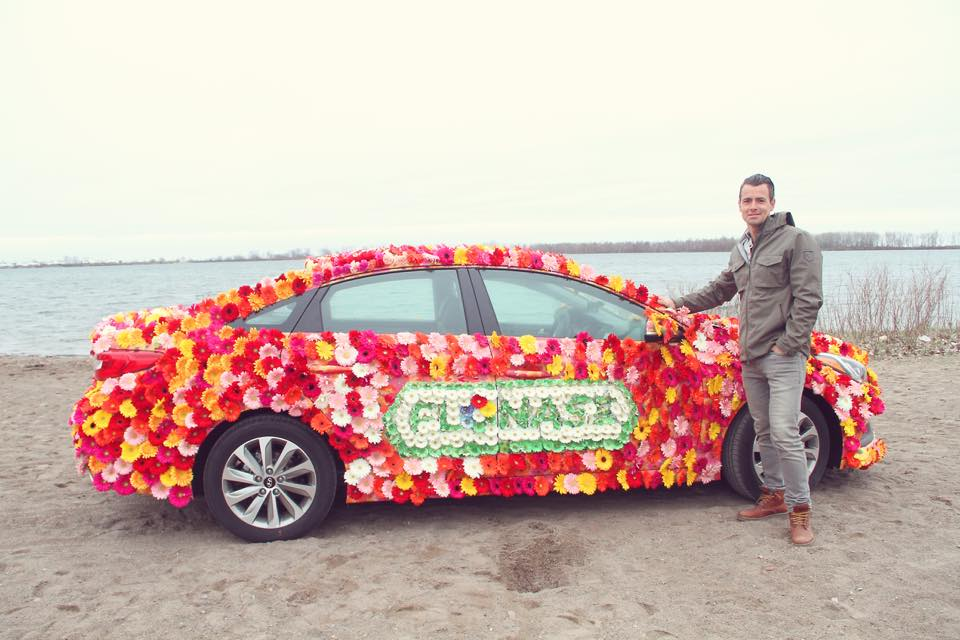 Adam van Koeverden with the Flonase Flower Car