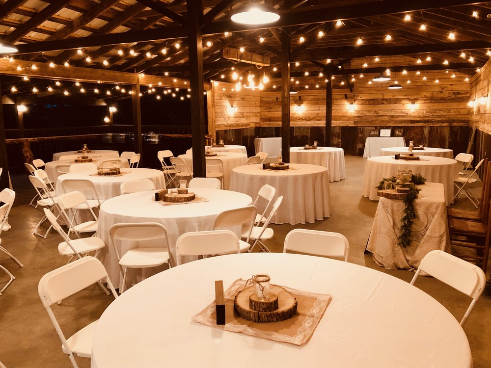 rustic and intimate wedding reception in the barn at the historic venue at old holler farm in rural hall, nc