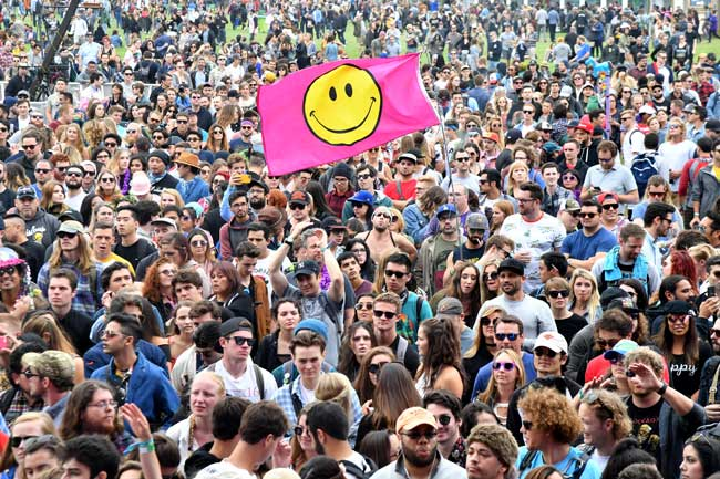 SAN FRANCISCO, CA - AUGUST 11, 2017:  Festival-goers at the Lands End Stage during the 2017 Outside Lands Music And Arts Festival at Golden Gate Park.