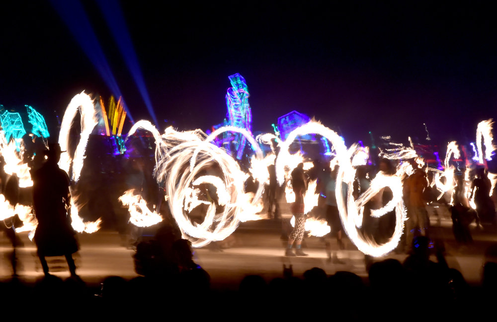 Before the Burn, thousands of fire dancers surround the Man and try to not set each other on fire