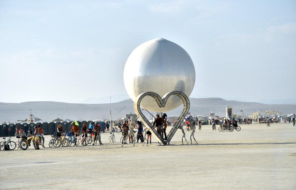 Porta potties, bikes, hearts, balls, mountains and people