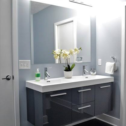 Steeltown Properties in Pittsburgh, Pennsylvania Offers Spacious, Updated Bathrooms with tiled showers, modern vanities, and artistic lighting fixtures