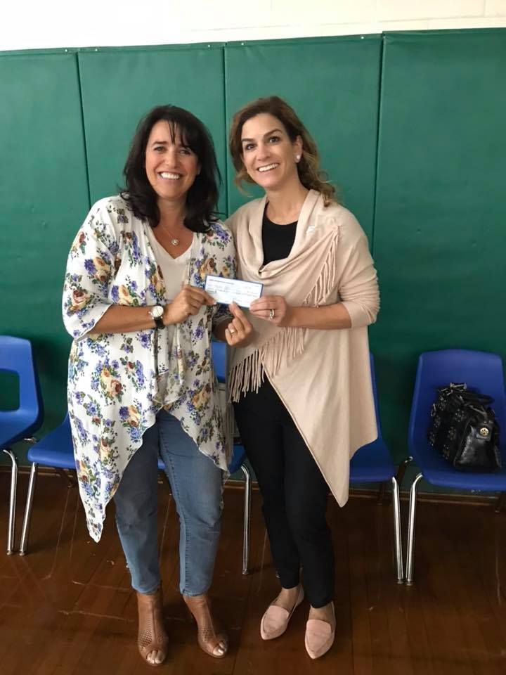 Michelle Eskow (AAKF Executive Director)presenting Laura Stanziano, and the Wayne Alliance with a check from the 7th annual poker tournament in honor of Albert Kayal, for next years event.