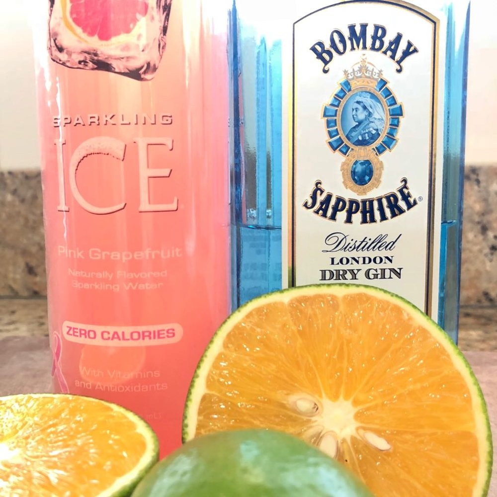 Sparkling Ice pink grapefruit sparkling water, gin, Valencia orange, and lime. -