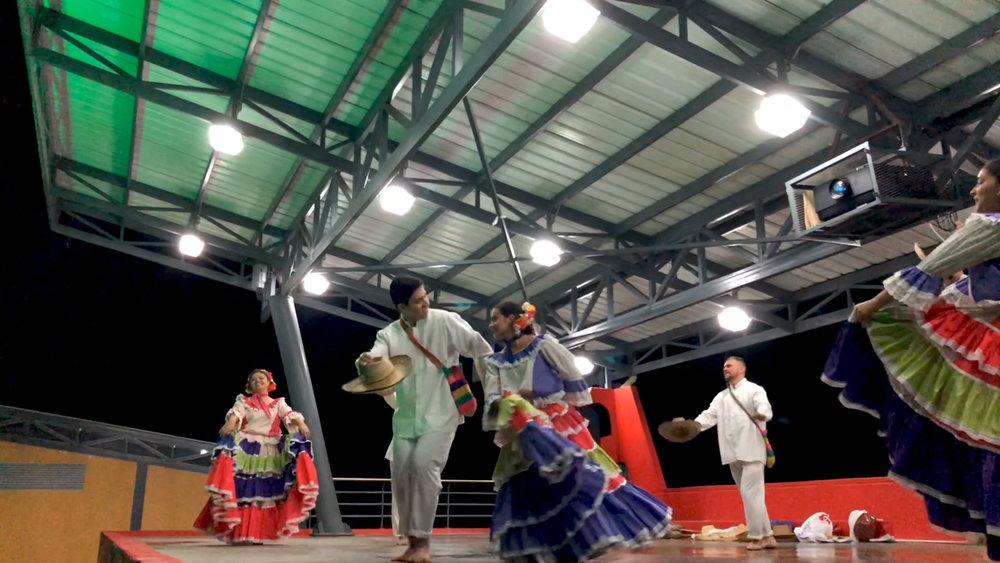 Dancers performing traditional Colombian dances at the Ecoparque Cerro del Santísimo