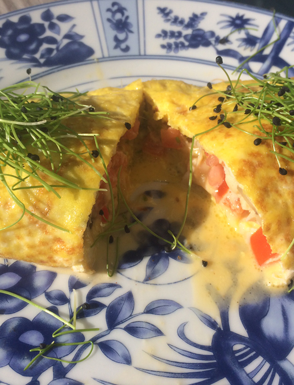 - Tomato Cheese Omelet topped with Micro Onion Shoots