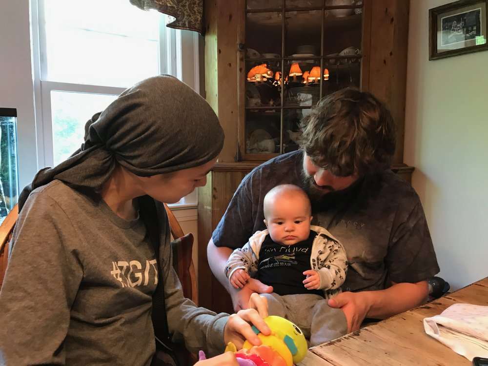 This is Maggie with Mr. Barrett and his son River, after gifting him with the signed Red Hot Chili Peppers Getaway Album.