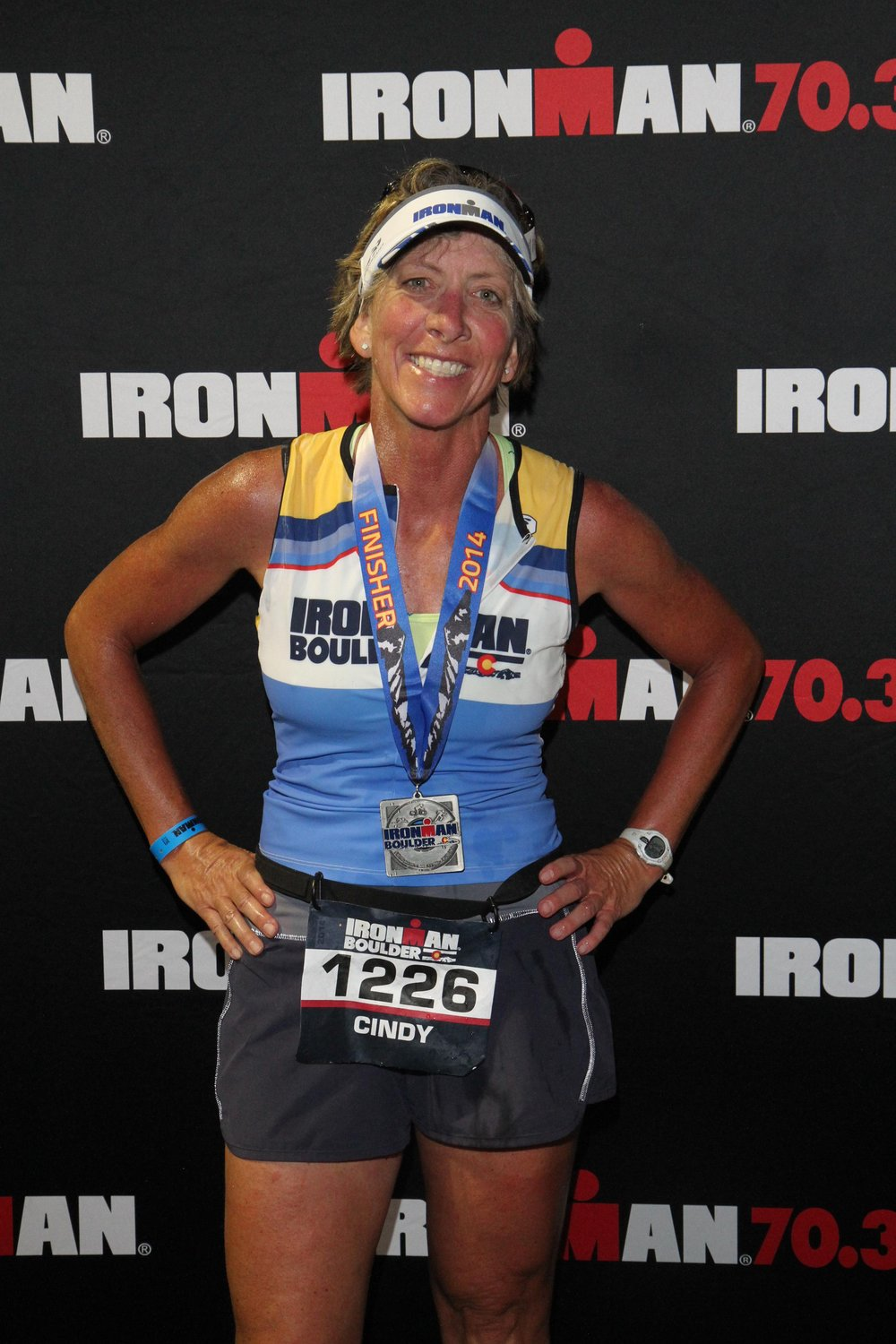 Dr. Cindy finishing the Boulder Ironman