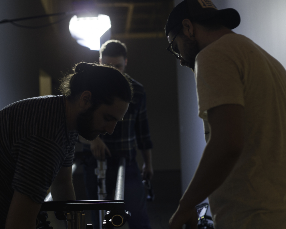 Sam, Tyler and Caleb setup rails for our dolly walking shot. (Photo: Ryan Kanaly)