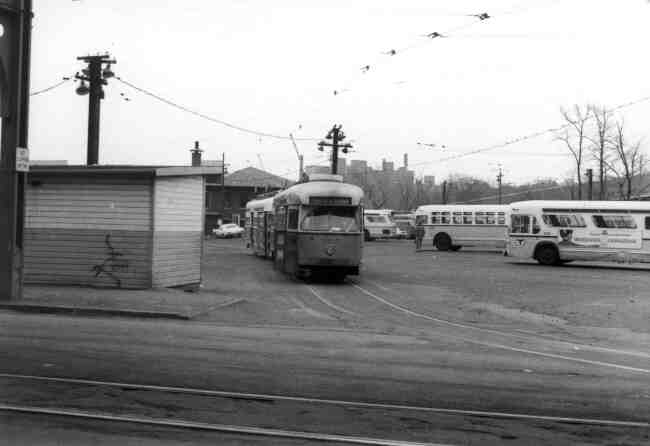 Trolley # 3217 waits for passengers at the exiting area of the Arborway yard on Washington Street in this late 1960s photo. The buses are located in the designated departure slots for later trips.