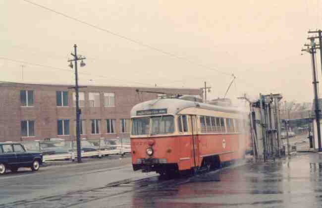 Trolley # 3326 is shown here in this 1967 photo at the Arborway yard getting a trolley wash. It appears that the machine goes around the trolley with a high pressure washing system.