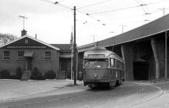 A trolley heading to Park Street Station passes the Jamaica Plain Post # 76 American Legion building on South Street near the Arborway in this 1960s photo.