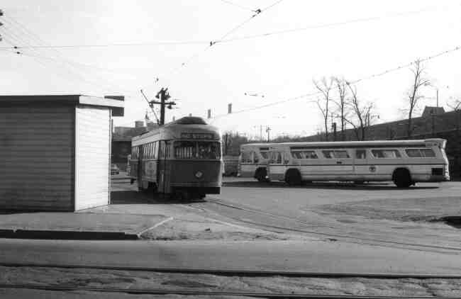 Trolley # 3229 is shown departing from the Arborway yard onto Washington Street in this late 1960s photo. The passenger shelter facility can be seen along with a few parked buses.
