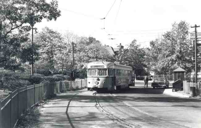 This photo at the Heath Street loop in 1966 shows a trolley driver waiting for his next trip. You can see the driver talking to the Inspector who made his rounds in an MBTA unmarked sedan.